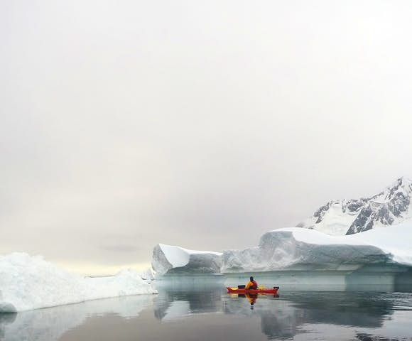 Kayaking amongst Antarctic icebergs