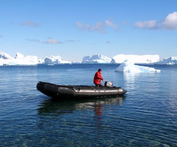 Cruising in a Zodiac among icebergs in Antarctica in February