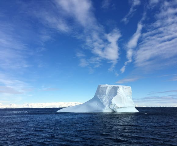 Majestic iceberg in the Crystal Sound, Polar Circle, Antarctica
