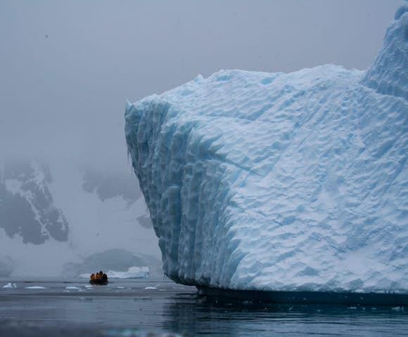 Zodiac cruising in Pleneau Bay's iceberg graveyard, Antarctica