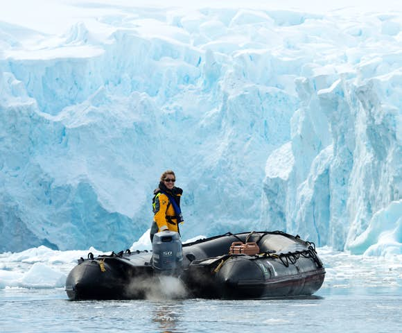 Approaching ice in a zodiac - Antarctica travel cost