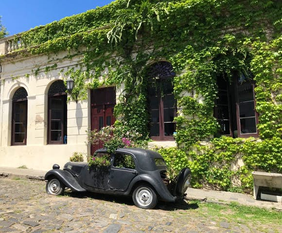 Vintage car parked outside colonial house in Colonia Sacramento, Montevideo, Uruguay